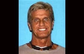 FILE - This file photo released by the Los Angeles County Sheriff's Department shows missing 20th Century Fox executive Gavin Smith who was last seen May 1, 2012. A convicted drug dealer was charged Thursday, Jan. 29, 2015, with the murder of Smith, who mysteriously disappeared more than two years ago and whose remains were found in a northern Los Angeles County desert area in October. John Lenzie Creech, 42, was charged with 57-year-old Smith's death, according to the Los Angeles County district attorney's office. (AP Photo/Los Angeles County Sheriff�s Department, File)