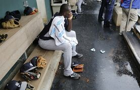New York Yankees starting pitcher Michael Pineda sits in the dugout during the Yankees seven-run, fifth inning in a spring training baseball game against the Philadelphia Phillies in Clearwater, Fla., Friday, March 27, 2015. Pineda was the winning pitcher in the Yankees 10-0 victory over the Phillies in a rain-shortened game. (AP Photo/Kathy Willens)