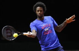 France's Gael Monfils returns the ball during a training session at the Pierre Mauroy stadium in Lille, northern France, Wednesday, Nov.19, 2014. France will face Switzerland in the Davis Cup final starting next Friday. (AP Photo/Michel Spingler)