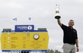 FILE - This is a Sunday, July 17, 2011 file photo of Northern Ireland's Darren Clarke as he holds up the Claret Jug trophy on the 18th green as he celebrates winning the British Open Golf Championship at Royal St George's golf course Sandwich, England. One of the three clubs on the British Open rota with a male-only membership policy has voted to allow female members for the first time. Royal St. George's, which last hosted golf's oldest major in 2011, said on Wednesday March 4, 2015 more than 81 percent of the club's full members took part in a ballot, and 90 percent voted in favor of women being eligible for membership. (AP Photo/Matt Dunham)