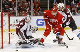 Colorado Avalanche goalie Calvin Pickard (31) stops a Detroit Red Wings left wing Justin Abdelkader (8) shot during the second period of an NHL hockey game in Detroit Sunday, Dec. 21, 2014. (AP Photo/Paul Sancya)