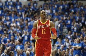 Houston Rockets' Dwight Howard gestures during the first half of Game 3 in an NBA basketball first-round playoff series against the Dallas Mavericks, Friday, April 24, 2015, in Dallas. (AP Photo/Tony Gutierrez)