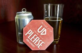 A coaster as part of an alcohol awareness campaign is seen Monday, April 27, 2015 in Iqaluit, Nunavut. Nunavut politicians are once again facing the emotional issue of whether to open the territory's first retail store to buy alcohol. THE CANADIAN PRESS/Paul Chiasson