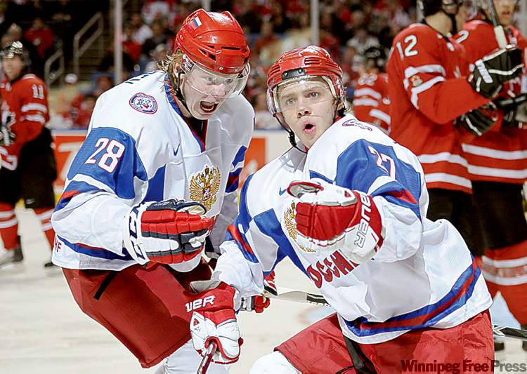 Team Russia's Artemi Panarin, right, celebrates with teammate Denis Golubev after scoring one of his two third-period goals against Team Canada in the championship game of the 2011 IIHF World Junior Hockey Championship played at HSBC Arena in Buffalo, N.Y.,  Wednesday.