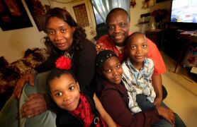 Gibril and Ann Marie Bangura with their three kids (left to right) Veralina, 5, Esther, 9, and Moses, 7.  The refugees from Sierra Leone arrived in Canada last February.