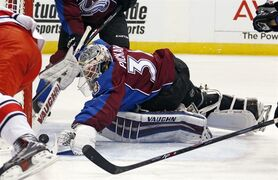 Colorado Avalanche goalie Calvin Pickard makes a save against the Carolina Hurricanes during the second period of an NHL hockey game Saturday, Nov. 22, 2014, in Denver. (AP Photo/Jack Dempsey)