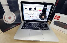 Beats Audio equipment is arranged for a photo next to an Apple laptop at Best Buy in Boston on May 9, 2014. THE CANADIAN PRESS/AP, Michael Dwyer