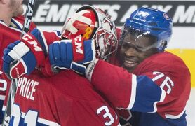 Montreal Canadiens' P.K. Subban, right, celebrates with goaltender Carey Price after defeating the Florida Panthers in a NHL hockey game in Montreal, Saturday, March 28, 2015. THE CANADIAN PRESS/Graham Hughes