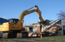 The home where three children were killed 7 years ago by their mentally ill father Allan Schoenborn in Merritt, B.C., was demolished Tuesday, March 31, 2015. The town's mayor says the home was an ugly reminder of a heinous crime. THE CANADIAN PRESS/Emily Wessel, Merritt Herald