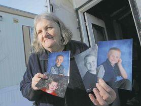 BORIS MINKEVICH / WINNIPEG FREE PRESSBeverley Eberhardt with photos of her grandsons (clockwise from bottom left): Henry, Timmy, Bobby and Danny.