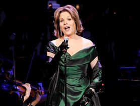 "FILE - In this April 17, 2014 file photo, soprano Renee Fleming performs at the 25th Anniversary Rainforest Fund benefit concert at Carnegie Hall in New York. Fleming will make her Broadway debut this spring, playing what else? An opera star. The four-time Grammy Award-winning soprano will star in the comedy ""Living on Love"" at the Longacre Theatre beginning April 1. (Photo by Evan Agostini/Invision/AP, File)"
