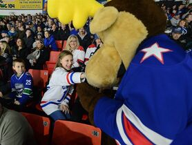 Mia Lopata, 11, of Clinton, reaches for the Rochester Americans' Moose during the AHL All-Star Classic at the Utica Memorial Auditorium, Jan. 26, 2015, in Utica, N.Y. (AP Photo/Observer-Dispatch, Mark DiOrio)