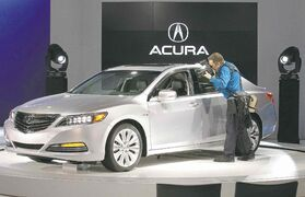 An Acura RLX Sport Hybid SH-AWD on display at the 2014 Montreal International Auto Show.