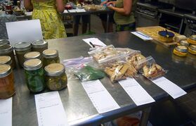 This July 27, 2014 photo shows wares available for trade a food swap in Portland, Ore. Swappers bring homemade goods to trade at food swaps in cities like Portland and Austin, Texas. (AP Photo/Molly Hottle)