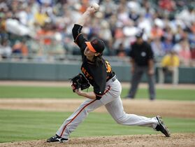 San Francisco Giants' Tim Lincecum throws during the third inning of a spring training baseball game against the Oakland Athletics, Tuesday, March 3, 2015, in Mesa, Ariz. (AP Photo/Darron Cummings)