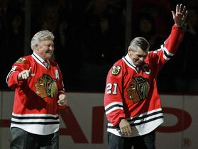 Chicago Blackhawks greats Bobby Hull, left, and Stan Mikita wave to fans as they are introduced before an NHL hockey game against the San Jose Sharks in Chicago on March 7, 2008. Chicago Blackhawks legend Stan Mikita is facing serious health issues after being diagnosed with a form of dementia. Mikita's family says the Hockey Hall of Famer is undergoing treatment for suspected Lewy body dementia. THE CANADIAN PRESS/AP, Brian Kersey