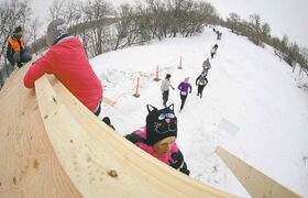 Participants make their way over the Tower of Power obstacle, during the Ice Donkey run at the University of Manitoba in February 2013.