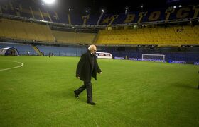 Carlos Bianchi, coach of Argentina's Boca Juniors backdropped by empty stadium seats prior to Argentina's soccer league match against Colon in Buenos Aires, Argentina, Saturday, May 18, 2013. The Argentina's soccer federation has ordered Boca Juniors to play in an empty stadium for one game, following disturbances during their last match against River Plate on May 5. (AP Photo/Eduardo Di Baia)