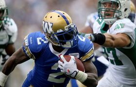 Bombers Jovon Johnson carries the ball during the first half of the Banjo Bowl.