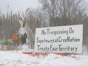 SUBMITTED PHOTOA sign in front of a teepee set up to protest the Bipole III route.