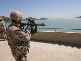 A Canadian soldier uses his rifle sights to survey the Arghandab River as it flows toward the Dahla Dam on May 21, 2009. THE CANADIAN PRESS/Colin Perkel