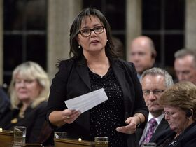 Environment Minister Leona Aglukkaq responds to a question during question period in the House of Commons in Ottawa on Oct.7, 2014. Canada's contribution to a major United Nations climate change conference later this year will be heavily dependent on actions by provincial and territorial governments. THE CANADIAN PRESS/Adrian Wyld
