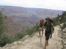 FILE- In this file photo taken Tuesday, April 28, 2009, Eliza Anti, 31, and Michael Parker, 32, of Hardwick, Vt., near the end of their days-long hiking and camping trip at the Grand Canyon. The Grand Canyon is imposing new restrictions on hikers who are turning up in larger numbers to complete grueling