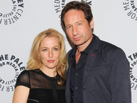 FILE - In this Oct. 12, 2013 file photo, actors Gillian Anderson and David Duchovny attend