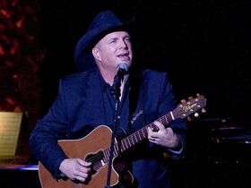 FILE - In this Nov. 17, 2014 file photo, Garth Brooks performs the 2014 ASCAP Centennial Awards, benefiting the ASCAP Foundation and its music education, talent development and humanitarian activities, at the Waldorf-Astoria in New York. Brooks has canceled a Thanksgiving appearance on NBC's