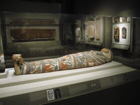 This Oct. 22, 2014 photo shows a mummy at the Walters Museum of Art in Baltimore. The museum collection was amassed by a father and son, and is known for its antiquities among other things. The mummy was determined to contain the body of a 60-year-old woman and is referred to as Mery _ pronounced Mary. (AP Photo/Beth J. Harpaz)