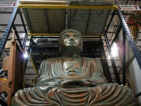 This Dec. 19, 2014 photo of a Buddha statue taken inside a warehouse for MGM resorts event productions in Las Vegas, Nev. Beyond the fireworks and crowds on the Las Vegas Strip are exclusive invite-only parties. Several are being produced by MGM Resorts' in-house events division which houses a whimsical collection of props and decorations at its warehouse off the Strip including a mirrored piano hanging from the ceiling and a large Buddha statue sitting on a shelf that's as large as a standing adult. (AP Photo/Kimberly Pierceall)