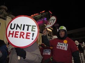 Union members march on the Atlantic City N.J. Boardwalk on Wednesday, Nov. 19, 2014, to protest the role of billionaire investor Carl Icahn in the planned closure of the Trump Taj Mahal Casino Resort. Icahn is willing to invest $100 million into the casino but only if Trump Entertainment Resorts gets $175 million in state and local aid, and the union withdraws its appeal of a bankruptcy court order that canceled employees' health insurance and pension plan. (AP Photo/Wayne Parry)