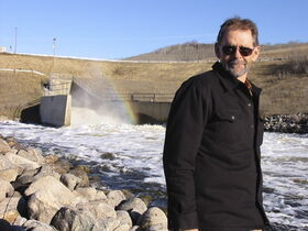 Cliff Trinder stands in front of the control gate at the Shellmouth reservoir in November 2010. He says the province's flood forecasting is 'abominable.'