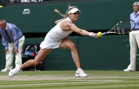 Eugenie Bouchard of Canada plays a return to Petra Kvitova of the Czech Republic during the women's singles final at the All England Lawn Tennis Championships in Wimbledon, London, Saturday, July 5, 2014. Bouchard will be the sixth seed at the upcoming Rogers Cup women's tennis tournament while fellow Canadian Milos Raonic will be seeded seventh in the men's event. THE CANADIAN PRESS/AP/Sang Tan