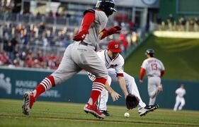 Washington Nationals starting pitcher Taylor Jordan fields a ball hit by St. Louis Cardinals Kolten Wong, who was safe at first, during the first inning of a baseball game at Nationals Park Thursday, April 17, 2014, in Washington. (AP Photo/Alex Brandon)
