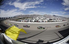 Dale Earnhardt Jr. (88) drives during a caution at a NASCAR Sprint Cup Series auto race Sunday, March 9, 2014, in Las Vegas. (AP Photo/Isaac Brekken)