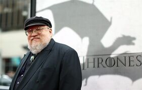 FILE - In this March 18, 2013 file photo, author George R.R. Martin arrives at the premiere for the third season of the HBO television series