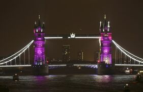 Tower Bridge is lit up to celebrate the Duke and Duchess of Cambridge's newborn baby, in London, Saturday May 2, 2015. Kate gave birth to their second child, a daughter, at St. Mary's Hospital in London on Saturday, May 2, and the baby's name is not yet announced. (Yui Mok/PA via AP) UNITED KINGDOM OUT, NO SALES, NO ARCHIVES