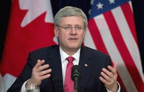 Canadian Prime Minister Stephen Harper speaks to business leaders during a meeting in New York, on May 16, 2013. THE CANADIAN PRESS/Adrian Wyld