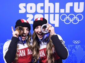Canadian sisters Justine Dufour-Lapointe, left, and Chloe Dufour-Lapointe, right, show off their gold and silver medals from women's freestyle moguls after the medal ceremony at the 2014 Sochi Winter Olympics in Sochi, Russia on Sunday, February 9, 2014. Freestyle skiing is getting a significant bump in Own The Podium funding this winter, while money for skeleton has been slashed almost to the bone.THE CANADIAN PRESS/Nathan Denette