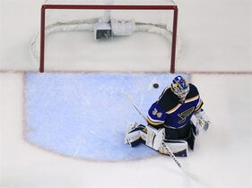 St. Louis Blues goalie Jake Allen kneels after giving up a goal to Minnesota Wild's Charlie Coyle during the third period in Game 5 of an NHL hockey first-round playoff series, Friday, April 24, 2015, in St. Louis. The Wild won 4-1. (AP Photo/Jeff Roberson)
