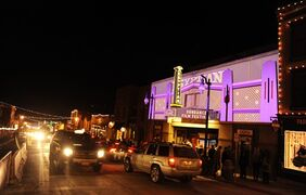 This Friday, Jan. 17, 2014 file photo shows a view of the Egyptian Theatre on Main Street on the second day of the 2014 Sundance Film Festival, in Park City, Utah. If you want to go big, go for a gift of a trip to the Sundance Film Festival in January. Held in picturesque Park City, Utah, the 10-day event is open to the public, with celebrity sightings, screenings, and filmmaker meet-and-greets in a festive, snowy atmosphere. (Photo by Chris Pizzello/Invision/AP, File)