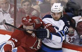 Phoenix Coyotes' Oliver Ekman-Larsson (23), gets hit in the face with a stick by Winnipeg Jets' Michael Frolik during the second period of an NHL hockey game, Tuesday, April 1, 2014, in Glendale, Ariz. The Jets have signed Frolik to a US$3.3-million, one-year contract. THE CANADIAN PRESS/AP Photo/Ross D. Franklin