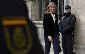 FILE - In this Feb. 8, 2014 file photo, Spain's Princess Cristina arrives at the courthouse in Palma de Mallorca, Spain after being named as a fraud and money laundering suspect. Spain's new King Felipe VI will give his first Christmas Eve speech amid intense interest over what he might say about his sister Princess Cristina's indictment two days ago on tax fraud charges. (AP Photo/Manu Fernandez, File)