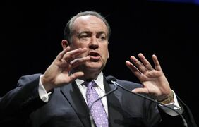 """FILE - This Aug. 9, 2014, file photo shows Former Arkansas Gov. Mike Huckabee as he speaks during The Family Leadership Summit, in Ames, Iowa. Conservatives should """"stop the fight"""" over Common Core and instead consider the benefits that the academic standards offer students in struggling schools, Huckabee said. The position puts him at odds with a significant bloc of Republicans. (AP Photo/Charlie Neibergall, File)"""