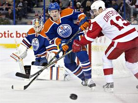 FILE - In this Jan. 6, 2015, file photo, Detroit Red Wings' Pavel Datsyuk (13) and Edmonton Oilers Jeff Petry (2), center, battle for the puck during first period NHL hockey action in Edmonton, Alberta. The Montreal Canadiens have made the first major move on the morning of the NHL's trade deadline day, Monday, March 2, 2015, by acquiring Jeff Petry from the Edmonton Oilers for draft picks. THE CANADIAN PRESS/Jason Franson