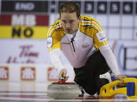 Manitoba skip Reid Carruthers delivers a rock as his tem plays Northern Ontario during curling action at the Brier in Calgary, Tuesday.