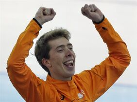 Gold medallist Jorrit Bergsma of the Netherlands celebrates after the final race in the men's 10,000-meter speedskating race at the Adler Arena Skating Center during the 2014 Winter Olympics in Sochi, Russia, Tuesday, Feb. 18, 2014. (AP Photo/David J. Phillip )