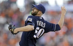 Milwaukee Brewers' Mike Fiers works against the San Francisco Giants in the second inning of a baseball game Saturday, Aug. 30, 2014, in San Francisco. (AP Photo/Ben Margot)