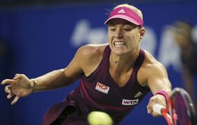 Angelique Kerber of Germany returns a shot against Dominika Cibulkova of Slovakia during their quarterfinals of the Pan Pacific Open Tennis tournament in Tokyo, Friday, Sept. 19, 2014. (AP Photo/Koji Sasahara)